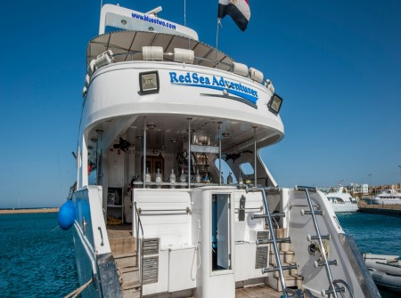 Stern of M/Y Red Sea Adventurer liveaboard diving vessel docked in Red Sea harbour